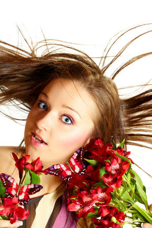 Attractive young woman with flowers, wind in hair photo