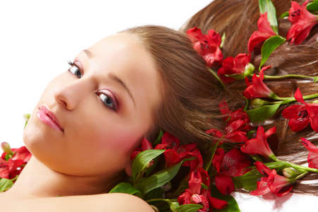 Laying beautiful  young woman with flowers photo