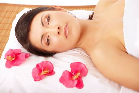 Attractive young woman relaxing in spa, beauty, wellness salon Stock Photo - 4751531