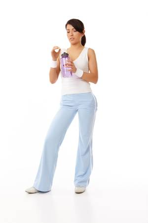 Portrait of fit young woman holding a water bottle Stock Photo - 4809799