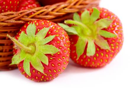 srawberries: Fresh srawberries some in basket isolated on white