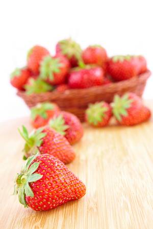 srawberries: Fresh srawberries in basket on the wooden table Stock Photo