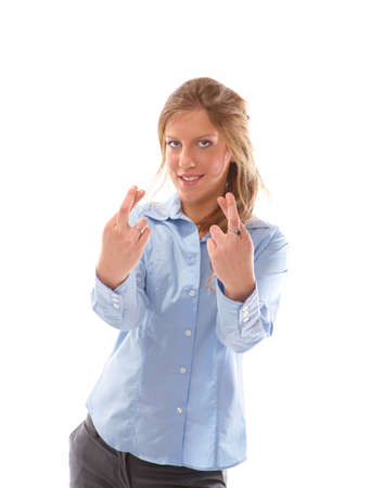 Closeup of a happy young female with fingers crossed on white hoping for the best Stock Photo - 6435806
