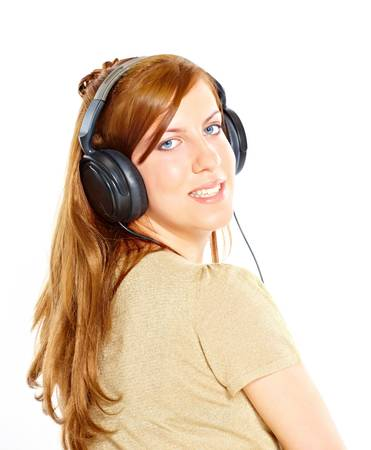 Girl with headphones looking back isolated over white background