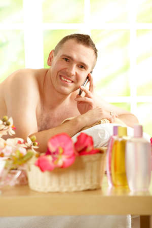 Even in spa business man is busy using his phone.  Stock Photo - 6435836