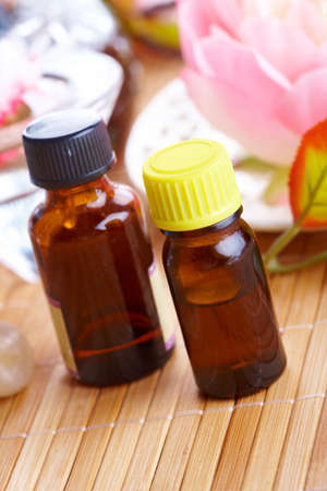 Tradicional alternative theraphy or medicine,  concept of healthy lifestyle, aromatherapy.Two bottles of aromatic oil with flowers in a background Stock Photo - 8887491
