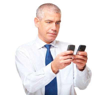 Mature businessman with two phones, isolated over white background. Stock Photo - 8887241