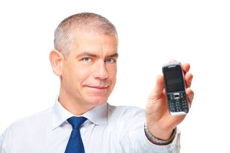Mature business man showing a mobile phone, isolated over white background. Stock Photo - 8887219