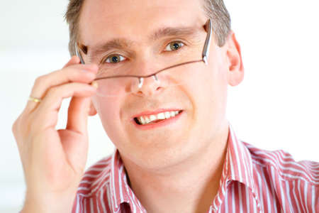 Close up of male face, man taking off glasses photo