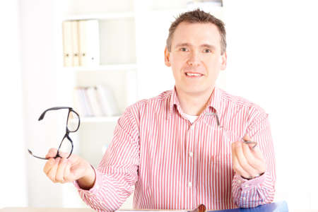 Male optician oculist presenting new glasses Stock Photo - 8887254