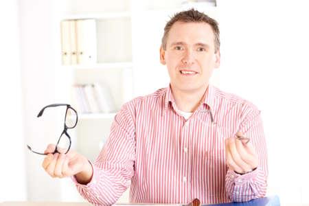 oculist: Male optician oculist presenting new glasses