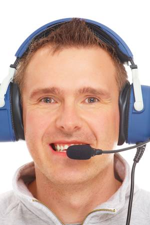 commentator: Cheerful man pilot with headset used in aircraft isolated on white background. Similar headphones are also used in communication so image also suits for radio TV  sport commentator and ATC controller.