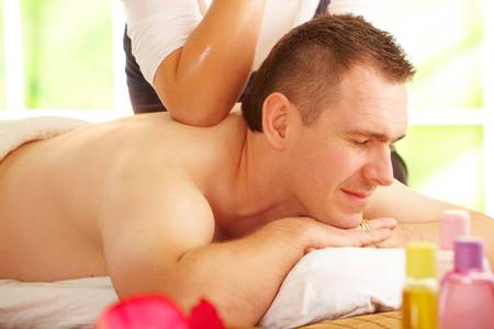 middle aged men: Male enjoying kind of Thai massage treatment with female hand back