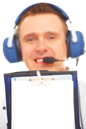 navigation aid: Smiling pilot with headset used in aircraft holding kneepad. Aid to navigation by pilots of planes consisting of a plate which has means for attaching it to the thigh of a seated pilot. Stock Photo