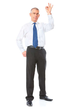 whole body: Happy mature businessman standing showing ok sign, meaning success in business. Full body image, isolated over white background.    Stock Photo