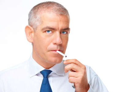 Mature man smoking cigarette with lighter in hand, isolated over white background photo