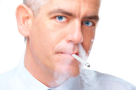 Face of mature man smoking cigarette exhaling smoke through nose, isolated over white background photo