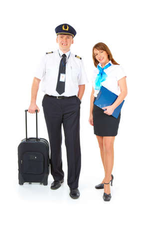 airline uniform: Flight crew. Cheerful pilot with trolley bag in hand and smiling flight attendant with documents wearing uniforms standing, isolated over white background