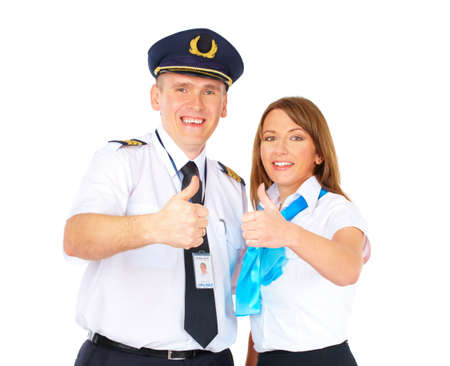 Flight crew wearing uniforms. Cheerful pilot and flight attendant gesturing thumb up meaning success and positive photo