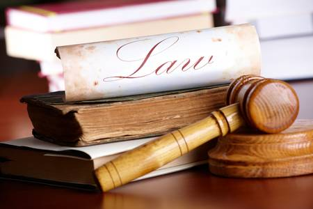 lawyer symbol: Judges wooden gavel with very old books and paper with word law