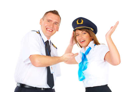 Flight crew wearing uniforms. Cheerful pilot gesturing with hand and laughing flight attendant with his hat  photo