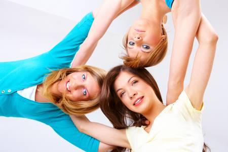 Three happy friends, beautiful girls hugging photo