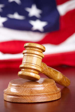 Judges wooden gavel with USA flag in the background Stock Photo - 8887433