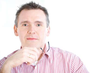hyperopia: Uomo d'affari fiducioso con galsses in mano. Quest'uomo potrebbe anche me un ottica o ottico. Archivio Fotografico