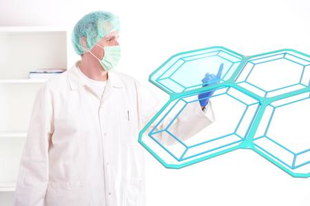 Researcher or a medic examining cells. This could be futuristic doctor using genetic engineering techniques or holographic methods of testing honeycomb cell. Stock Photo - 9502649
