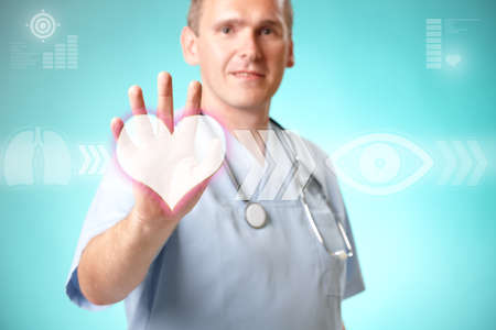 Medicine doctor working with futuristic interface, he chooses heart symbol to do cardiac test for his patient. photo