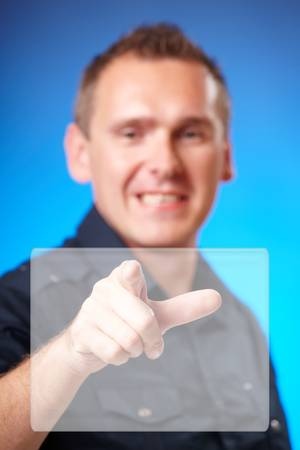 Man using holographic interface, pressing white screen Stock Photo - 9816388