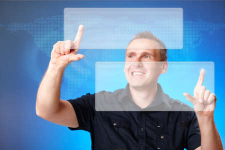 Man using holographic interface, pressing white  buttons with word map in the background Stock Photo - 9816389