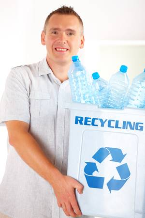 Happy man holding bin full of plastic blue bottles Stock Photo - 10101414