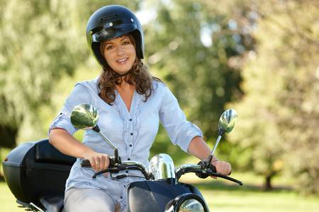Woman ride retro motorbike scooter  photo