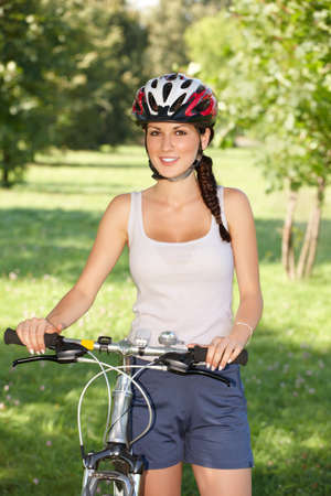 bicyclists: Young woman, biker with her bike Stock Photo