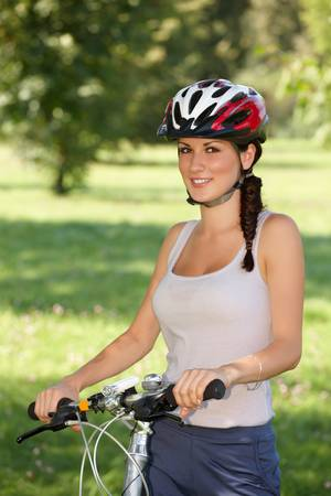 Young woman, biker with her bike photo