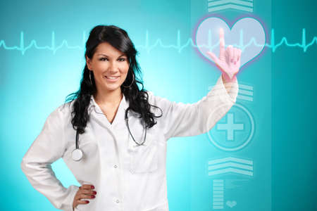 Medicine doctor working with futuristic interface, she is choosing heart symbol to do cardiac test for his patient. Stock Photo - 11367354