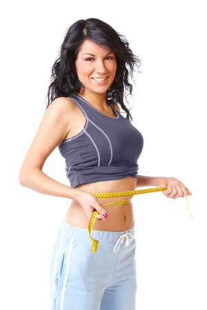 weight: Sporty girl measuring her weist with tape, weight loss