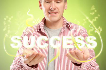 Man with word sucess over his hands. Concept of successful people and positive thinking. Stock Photo - 11367347