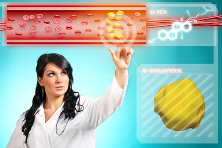 cardiovascular: Young woman doctor working with modern interface, testing blood and finding cholesterol Stock Photo