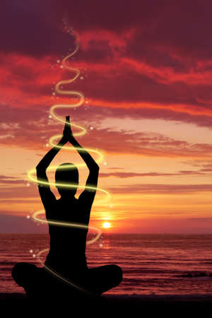 positions: Woman doing yoga exercise at the beach, energetic light and glow effect.