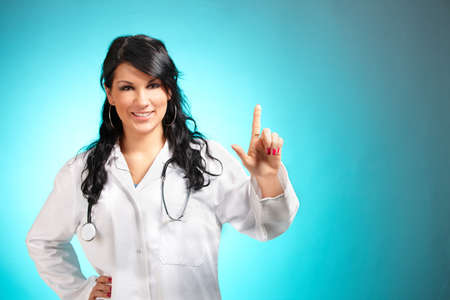 Medicine doctor pionting at something with her finger, space is left blank to add your text or graphic photo