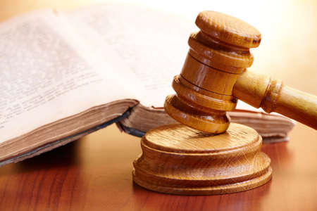 lawsuit: Old book and gavel Stock Photo