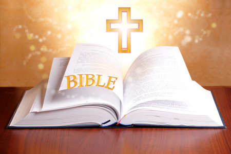 theology: Open holy bible with peaceful light and cross Stock Photo