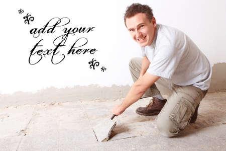 tile flooring: Happy manual worker disassembling old floor tiles