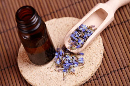 remedy: Dried lavender petals with macerated oil on the stone mat Stock Photo