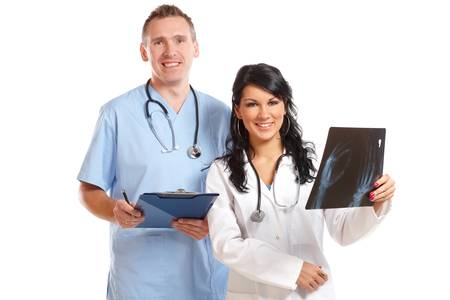 Two happy doctors having medical consultation of x-ray image Stock Photo - 12043029
