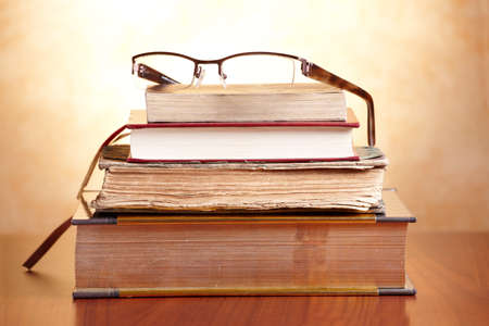bible study: Old books with glasses on the wooden table Stock Photo