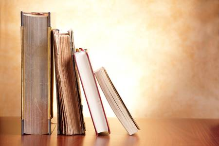 Old books on the wooden table photo