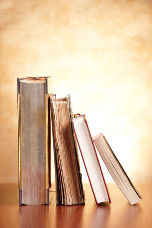 publish: Old books on the wooden table Stock Photo